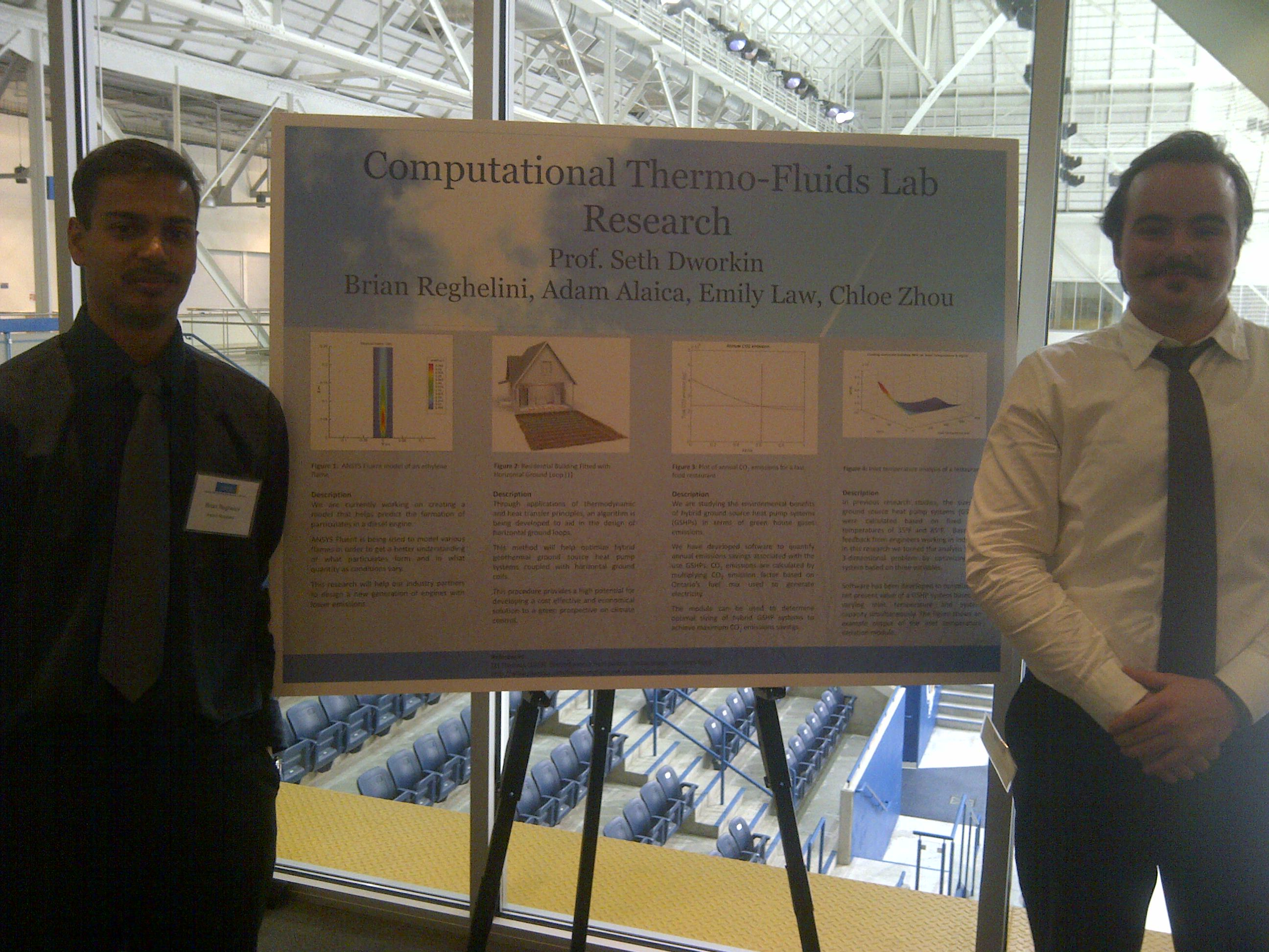 Left: Brian Reghelini and Right: Adam Alaica with their research poster at the 2013 MIE awards night